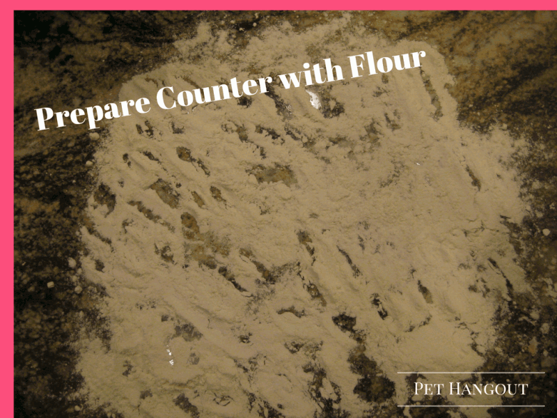 Prepare counter with flour