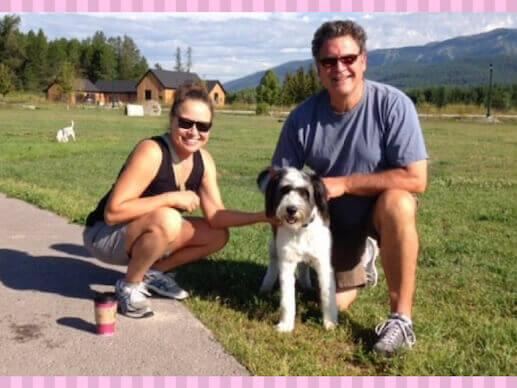 A dog and his parents at Hugh Rogers Dog Park